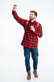 Man holding cup with coffee and making selfie photo Royalty Free Stock Photography