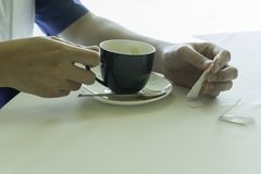 A man holding a cup of coffee Royalty Free Stock Image
