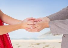 Man holding cupped hands of woman Royalty Free Stock Photos