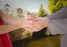 Man holding cupped hands of woman Stock Image