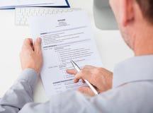 Man holding curriculum vitae Stock Image