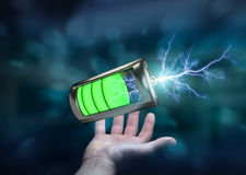 Man holding 3D render battery with lightning in his hand. Man on blurred background holding 3D render battery with lightning in his hand Stock Photography