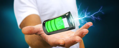 Man holding 3D render battery with lightning in his hand. Man on blurred background holding 3D render battery with lightning in his hand Stock Images