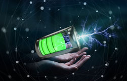 Man holding 3D render battery with lightning in his hand. Man on blurred background holding 3D render battery with lightning in his hand Royalty Free Stock Photography