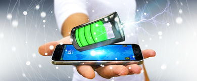 Man holding 3D render battery with lightning over his phone. Man on blurred background holding 3D render battery with lightning over his phone Royalty Free Stock Photography