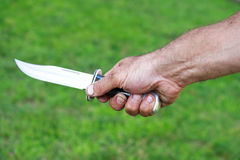 Man holding dagger Royalty Free Stock Photos