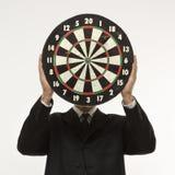 Man holding dartboard royalty free stock photography