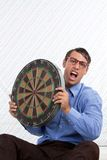 Man Holding a Dartboard Stock Photo