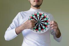 Man holding a dartboard Stock Image