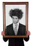 Man holding a decorative frame and standing inside Royalty Free Stock Images