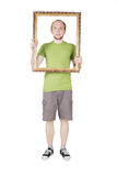 Man holding decorative picture frame Stock Images
