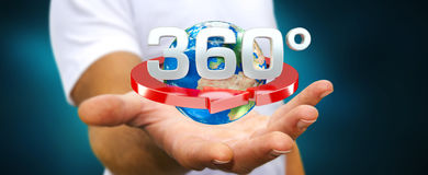 Man holding 360 degree 3D render icon in his han. Man on blurred background holding 360 degree 3D render icon in his hand Stock Images