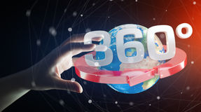 Man holding 360 degree 3D render icon in his han. Man on blurred background holding 360 degree 3D render icon in his hand Royalty Free Stock Images