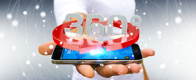 Man holding 360 degree 3D render icon over mobile phone. Man on blurred background holding 360 degree 3D render icon over mobile phone Royalty Free Stock Photography