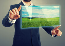 Man holding digital screen Royalty Free Stock Images