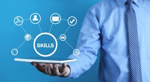 Man holding digital tablet. Business Skills Concept royalty free stock image