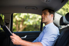 Man holding digital tablet in car Royalty Free Stock Photo