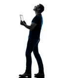 Man holding digital tablet  looking up silhouette Stock Photos