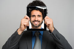 Man holding a digital tablet Royalty Free Stock Photo
