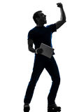 Man holding digital tablet  silhouette Royalty Free Stock Photography