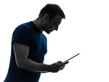 Man holding digital tablet smiling silhouette stock photography