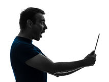 Man holding digital tablet  surprised silhouette. One  man holding digital tablet surprised in silhouette on white background Royalty Free Stock Photos