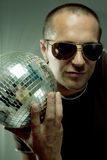 Man holding disco ball Stock Photography
