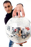 Man holding disco ball like a globe Stock Photos
