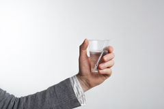 Man holding a disposable plastic cup with water. The lack of dri Stock Photos
