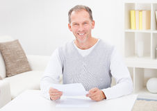 Man Holding Document Stock Images