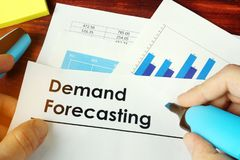 Man holding documents with Demand Forecasting. Man holding documents with name Demand Forecasting stock image