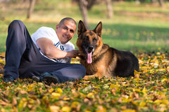 Man Holding Dog German Shepherd Royalty Free Stock Photography