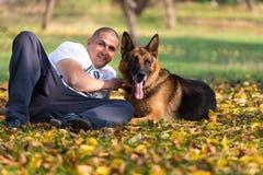 Man Holding Dog German Shepherd Royalty Free Stock Photography