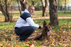 Man Holding Dog German Shepherd Stock Image