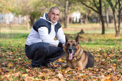 Man Holding Dog German Shepherd Royalty Free Stock Image