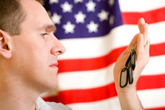 Man holding dog-tags Royalty Free Stock Photography