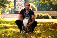 Man Holding Dog Stock Photography