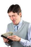 Man holding dollars Stock Image
