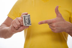 Man holding dollars and indicating on their Stock Photography