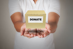 Man holding donate box Stock Image
