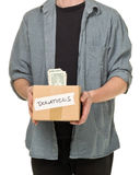 Man holding donation cardboard box with dollar banknotes Royalty Free Stock Image