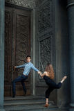 Man holding door handle and  girl to a guy, dance. Stock Photo
