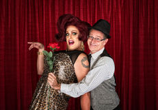 Man Holding Drag Queen. Man in hat attracted to drag queen Stock Photo