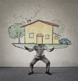 Man holding a drawn house Stock Image