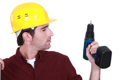 Man holding drill Royalty Free Stock Photos