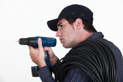 A man holding a drill. Royalty Free Stock Photo