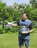 Man holding a drone and remote control royalty free stock photography