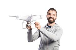 Man holding drone. Studio shot on white background, isolated Stock Photography