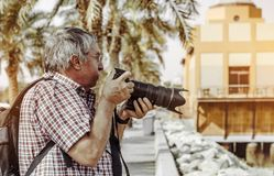 Man Holding Dslr Camera Stock Photo