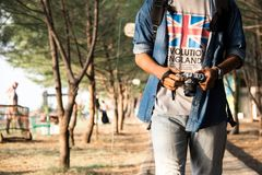 Man Holding Dslr Camera While Walking Royalty Free Stock Image